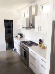 white kitchen with polished concrete floor