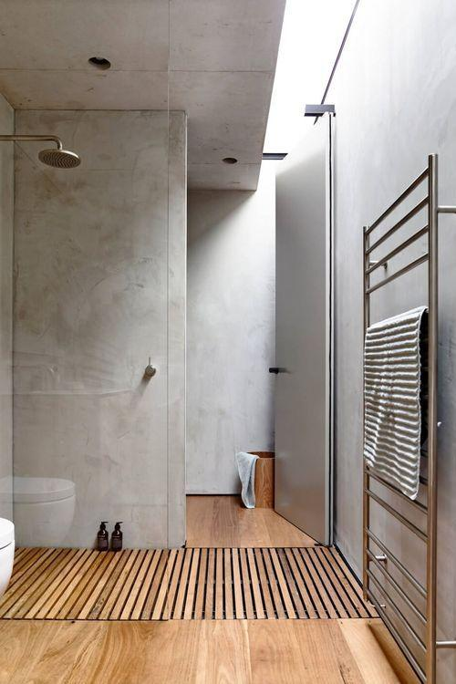 minimalist grey bathroom with timber flooring